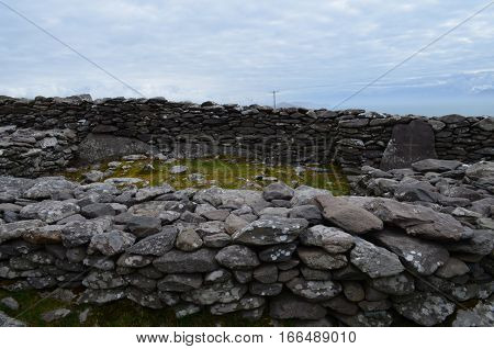 Stone ruins of a beehive hut village on Slea Head Penninsula.
