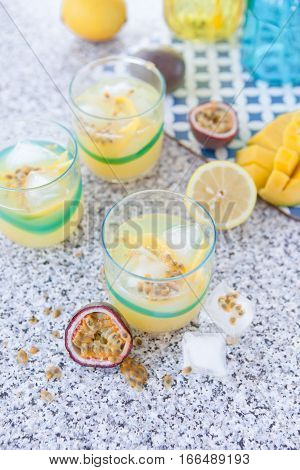 Colorful cocktail with exotic passion fruit and mango