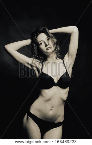Seductive naked lady in undrewear over dark background