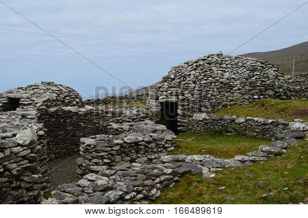 Village of beehive huts on Slea Head Penninsula Ireland.