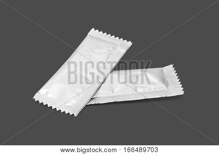 blank packaging sugar foil sachet isolated on gray background with clipping path