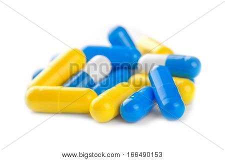 Pile Of  Blue, Yellow Color Medical Pills On White Background