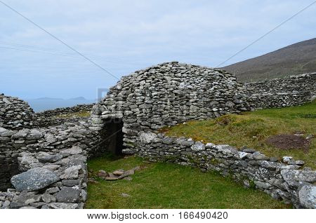 Beehive huts still standing on the Dingle Penninsula in Ireland.