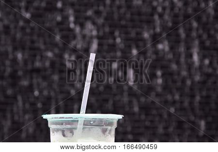 drink straw on plastic cup in water drop background