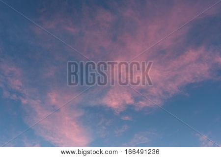 Pink cBeautiful pink clouds on blue sky at sunset in summer.louds on blue sky at sunset in summer.