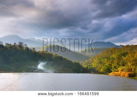Landscape with lake mountains and beautiful clouds. Nothern Thailand. Pai