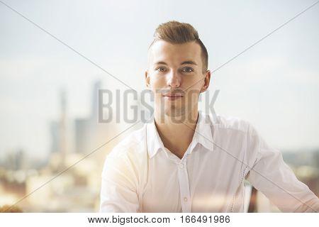 Close up portrait of attractive european gentleman in formal shirt