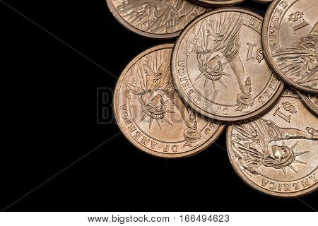 us coin dollar isolated on black background.