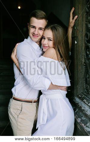 couple posing in the doorway posing on camera
