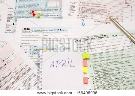 1040 tax form with note, pen close up