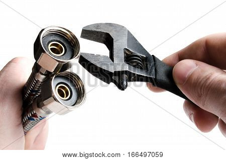 Flexible hose for water connection and the key