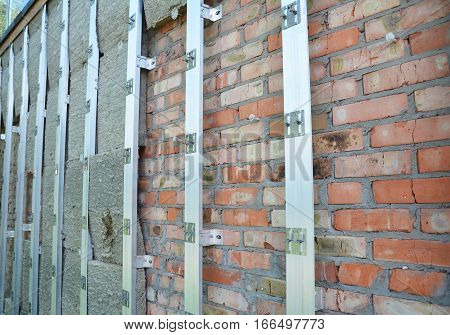 Brick house wall repair and rock wool or mineral wool wall insulation. External wall insulation - Save energy.