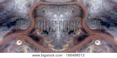 Effects of wind erosion on sand and desert rocks, symmetrical photographs of landscapes of the deserts of Africa from the air,