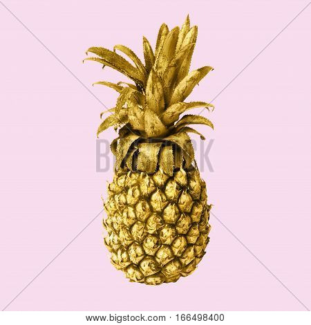 Gold pineapple isolated on pink background, art-work