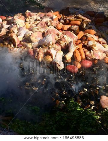 ACHAO CHILE - FEBRUARY 6 2016: The traditional Chilotan dish Curanto al hoyo is being prepared at the Muestras Gastronomicas 2016 Gastronomy Show in Achao