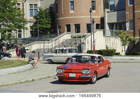 Fairhaven Massachusetts USA - July 4, 2016: Classic cars lined up in front of Fairhaven High School for annual Fairhaven Fourth of July Car Cruise