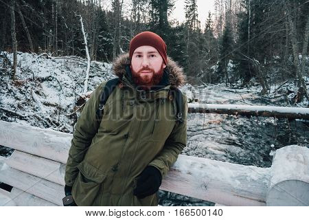 bearded hipster outdoors in winter. Portrait of a bearded man in a winter forest