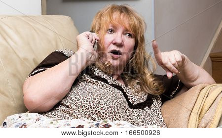 Beautiful senior woman is furious on the phone.