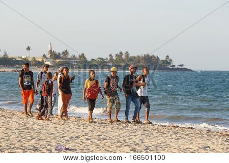 Malagasy Teenagers Boys Resting On The Beach