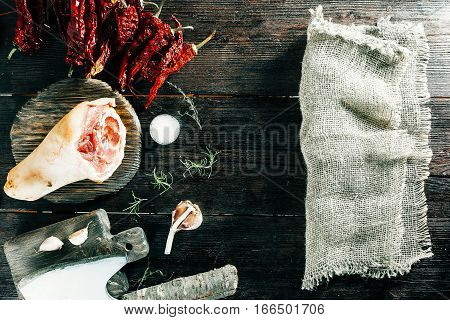 Raw pork leg, chopper and spices. Burlap for text