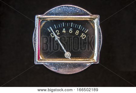 Rectangular old oil gauge for oil pressure. Isolated over black background