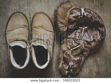 Dirty winter boots worker and winter hat