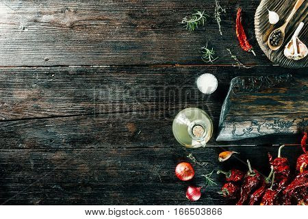 Variety of spices and condiments for cooking meat or fish on wooden boards