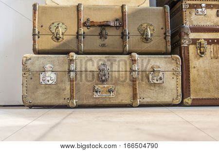 Antique brown leather luggage suitcases on the floor