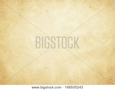 Aged dirty and yellowed paper background. Grunge paper texture for the design.