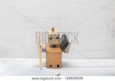 Robot holding a pen writing in diaries and talking on the phone. Artificial Intelligence
