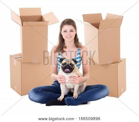 Young Woman With Brown Cardboard Boxes And Cute Pug Dog Isolated On White