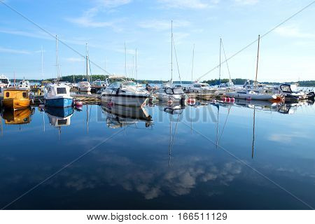 LAPPEENRANTA, FINLAND - AUGUST 21, 2016: Yachts and boats on the Saimaa lake in the early August morning