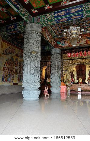 George Town/Malaysia - September 2012: People pray in pagoda in Kek Lok Si temple complex in George Town Penang Malaysia