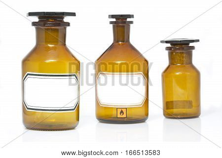 Vintage apothecary bottles with label on white background