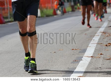 Athletic Runner With Elastic Band At The Knee Running Fast Durin