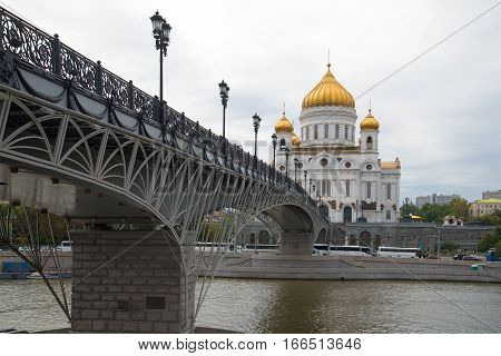 MOSCOW, RUSSIA - SEPTEMBER 07, 2016: View of Patriarshy Bridge and and Cathedral of Christ the Savior in the cloudy September afternoon