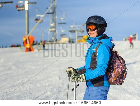 Portrait Of Young Happy Woman Skier At The Ski Resort