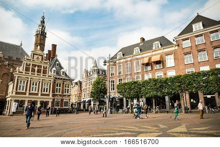 HAARLEM NETHERLANDS - 26 AUGUST 2014: Tourists and locals in the central square of Haarlem Holland.