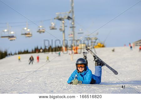 Young Woman Skier After The Fall On Mountain Slope