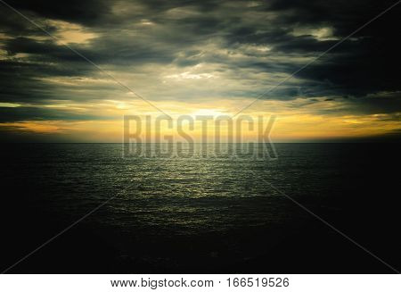Sunset Over The Sea With A Dark Vignette
