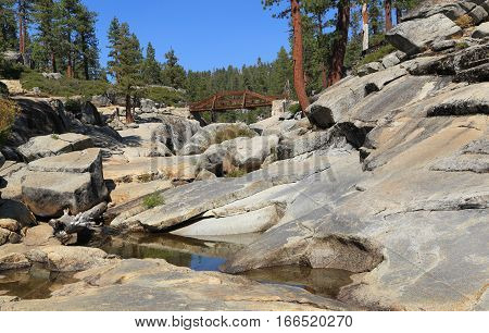 Pools of standing water in the rocky creek bed of Yosemite Creek during the dry season. Photographed at Upper Yosemite Fall during late summer.