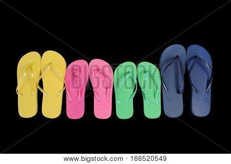 colorful flip flop sandals on black background