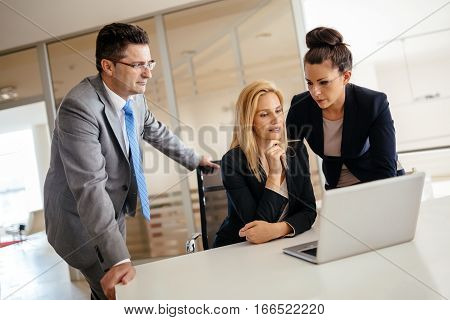 Busy business people and secretary at office