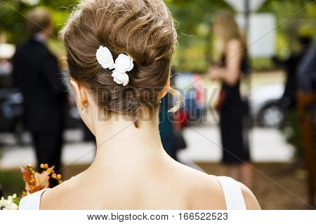 bride's back. beautiful hairstyle and the back of the bride closeup outdoors. rear view. back to the camera