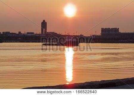 Boston Massachusetts USA - July 21, 2016: Hazy windless summer sunrise on Boston waterfront