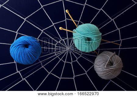 skeins of yarn on the web of woolen yarn