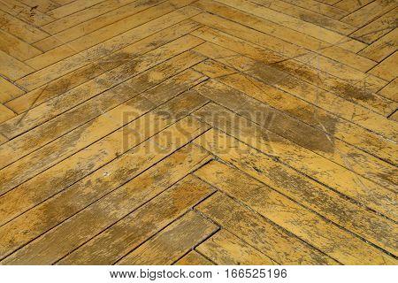 Dark background floor. Old parquet for repair.Batten in herringbone