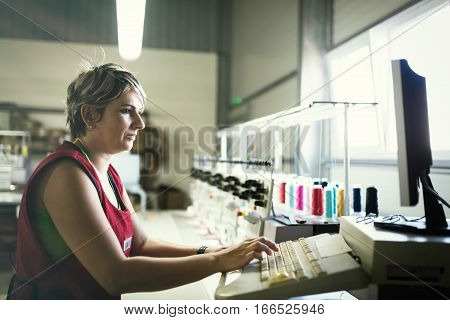 Young woman working in computerized fabric industry