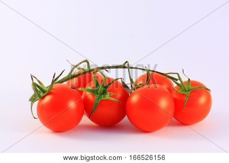 Red cherry tomatoes on a white background
