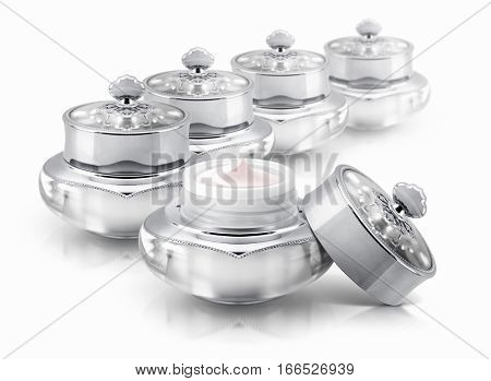 Several silver deluxe cosmetic jar on white background